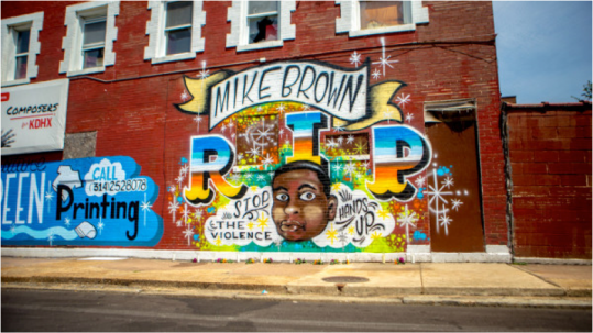 "A mural in memoriam of Mike Brown, an unarmed black teenager shot by police in Ferguson, Missouri was painted on the side of a business in North St. Louis. The tribute was done by artist Joseph Albanese and commissioned by Signature Screenprinting according to the St. Louis Dispatch. It's a ""dedication to the Mike Brown tragedy and awareness of injustice in our communities,"" wrote the custom t-shirt maker on its Facebook page. Funeral services for Brown will be held at the Friendly Temple Missionary Baptist Church on Monday. (Photo: Aymann Ismail/ANIMALNewYork) http://iamturbo.com/wp-content/uploads/2014/08/ferguson-mike-brown-mural_-600x3371.jpg"