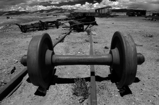 Derailed train axle at Uyuni's train cemetery, Bolivia.