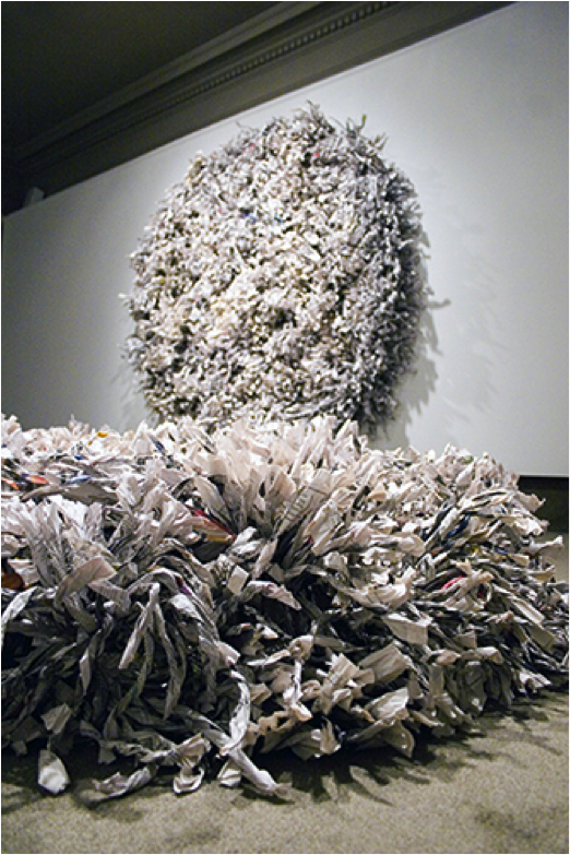 """Wrenching News,"" 2010. Shredded, twisted, and wrapped newspapers (New York Times). Wall: 7′ x 7′ x 1′. Floor: 6′ x 6′ x 1′. http://museum.spelman.edu/wp-content/uploads/2013/07/LIVES20_0.jpg"
